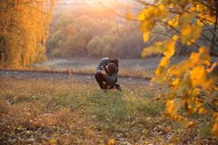 Young guy with a camera in his hands in the autumn Park. Moscow. royalty free stock image