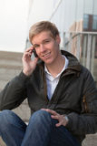 Young guy with cellphone Royalty Free Stock Photos