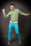 Young guy in a checkered shirt Stock Photography