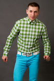 Young guy in a checkered shirt Stock Image