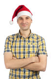 Young guy with christmas hat Royalty Free Stock Images