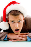 Young guy with christmas hat looking at camera Stock Photography