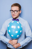 Young guy with a colorful balloon in his hand. Party, birthday, Valentine Stock Photography