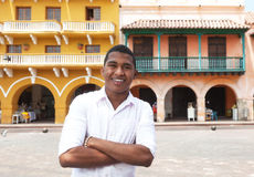 Young guy with crossed arms in a colonial town Stock Photos