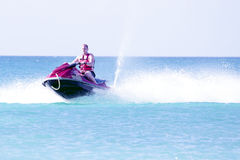 Young guy cruising on a jet ski. Young guy cruising in the caribbean sea on a jet ski Stock Images