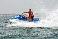 Young guy cruising on a jet ski. On the atlantic ocean Royalty Free Stock Images
