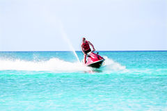 Young guy cruising on a jet ski Royalty Free Stock Photos