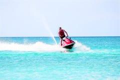 Young guy cruising on a jet ski Royalty Free Stock Photos