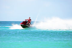 Young guy cruising on a jet ski on the caribbean sea Stock Photography