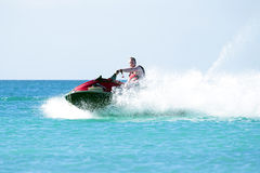 Young guy cruising on a jet ski Royalty Free Stock Images