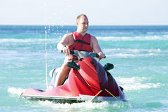 Young guy cruising on a jet ski Stock Photography
