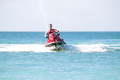 Young guy cruising on a jet ski Stock Images