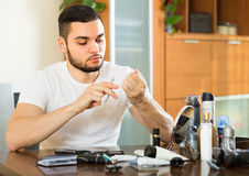Young guy cutting nails Stock Image