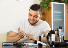Young guy cutting nails Stock Photos