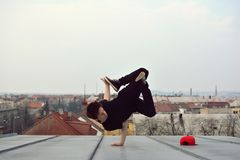 Young guy dancing break dance on the roof Royalty Free Stock Photos