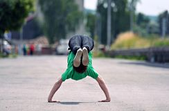 Young guy dancing breakdance on the street Royalty Free Stock Images