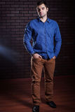 Young guy in a denim shirt posing Royalty Free Stock Photo