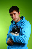 Young guy with a dog Stock Images