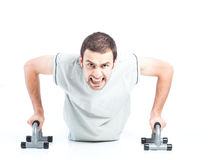 Young guy doing push ups Stock Photography