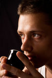 Young guy drinking Stock Photography