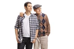 Young guy and an elderly man looking away stock photography