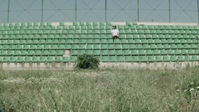 Young guy in an empty stadium