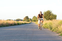 Young guy is engaged in cycling Royalty Free Stock Photo