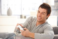 Young guy enjoying computer game Royalty Free Stock Images