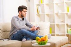 Young guy enjoying computer game Stock Photo