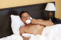 Young guy enjoying a cup of coffee Royalty Free Stock Photo