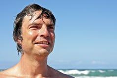 Young guy enjoying holidays at the beach Royalty Free Stock Image