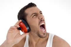 Young guy enjoying rock music with full volume Stock Photo