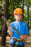 Guy with equipment climber holding anchor. Royalty Free Stock Images
