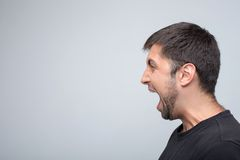 Young guy is expressing his negative emotions Stock Image