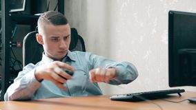 The young guy forgot to connect the mouse cord to the computer stock footage
