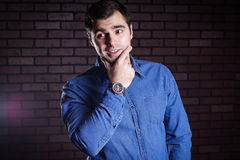 Young guy  frowns Royalty Free Stock Image