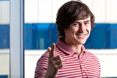 Young guy gesturing with a YOU sign Stock Photography