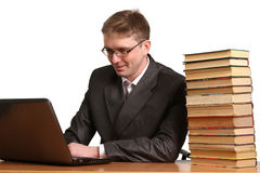Young guy  get information from a laptop Royalty Free Stock Photos