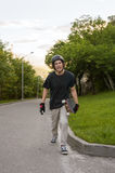 The young guy gets angry after the longboard trick does not work out Stock Photos