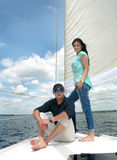 Young guy and girl on deck of the yacht Royalty Free Stock Photography