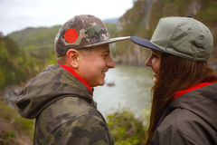 Young guy and girl in the mountains of Altai on the Katun River. Royalty Free Stock Photography