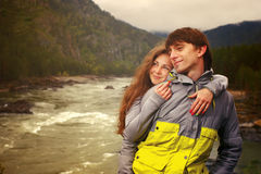 Young guy and girl in the mountains of Altai on the Katun River. Royalty Free Stock Image