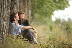 Young guy and girl on nature Stock Photo