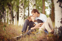 Young guy and girl on nature Royalty Free Stock Photography