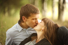 Young guy and girl on nature Royalty Free Stock Photo