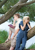 Young guy and girl on nature near lake, quarrel Royalty Free Stock Photo