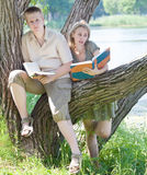The young loving couple reads books Stock Images