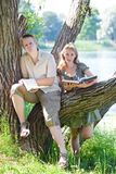 Teenagers in love on the river bank Stock Photos