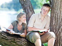 Young pair of people in a summer garden Royalty Free Stock Photo