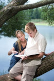 Young guy and the girl prepare for lessons Royalty Free Stock Photo